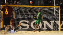 PAPEETE, FRENCH POLYNESIA - SEPTEMBER 27:  Nico of Spain (L) watches as his shot bounces over goalkeeper Mao of Brazil and into the goal during the FIFA Beach Soccer World Cup Tahiti 2013 Semi Final match between Spain and Brazil at the Tahua To'ata Stadium on September 27, 2013 in Papeete, French Polynesia.  (Photo by Mike Hewitt - FIFA/FIFA via Getty Images)