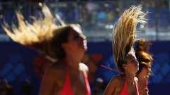 RAVENNA, ITALY - SEPTEMBER 06:  The Beach Babe cheerleaders dance during the FIFA Beach Soccer World Cup Group D match between Ukraine and Mexico at Stadium del Mare on September 6, 2011 in Ravenna, Italy.  (Photo by Dean Mouhtaropoulos - FIFA/FIFA via Getty Images)