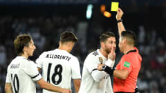 ABU DHABI, UNITED ARAB EMIRATES - DECEMBER 22:  Sergio Ramos of Real Madrid is shown a yellow card by referee Jair Marrufo during the FIFA Club World Cup UAE 2018 Final between Al Ain and Real Madrid at the Zayed Sports City Stadium on December 22, 2018 in Abu Dhabi, United Arab Emirates.  (Photo by David Ramos - FIFA/FIFA via Getty Images)