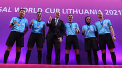 KAUNAS, LITHUANIA - OCTOBER 03: Gianni Infantino, President of FIFA poses alongside the Match Officials following the FIFA Futsal World Cup 2021 Final match between Argentina and Portugal at Kaunas Arena on October 03, 2021 in Kaunas, Lithuania. (Photo by Alex Caparros - FIFA/FIFA via Getty Images)