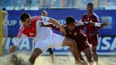RAVENNA, ITALY - SEPTEMBER 06: Dmitry Shishin is challenged by Pedro Romero of Venezuela during the FIFA Beach Soccer World Cup Group C match between Venezuela and Russia at Stadium del Mare on September 6, 2011 in Ravenna, Italy.  (Photo by Lars Baron - FIFA/FIFA via Getty Images)