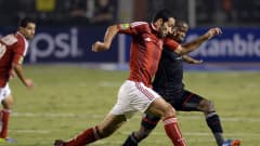 Egypt's Mohamed Aboutreika (L) of al-Ahly vies for the ball against Thabo Matlaba of South Africa's Orlando Pirates