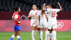 SAPPORO, JAPAN - JULY 24: Janine Beckie #16 of Team Canada celebrates with teammates after scoring their side's first goal during the Women's First Round Group E match between Chile and Canada on day one of the Tokyo 2020 Olympic Games at Sapporo Dome on July 24, 2021 in Sapporo, Hokkaido, Japan. (Photo by Masashi Hara/Getty Images)