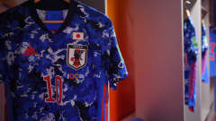 VILNIUS, LITHUANIA - SEPTEMBER 20: Katsutoshi Henmi of Japan shirt hangs in the dressing room prior to the FIFA Futsal World Cup 2021 group E match between Japan and Paraguay at Vilnius Arena on September 20, 2021 in Vilnius, Lithuania. (Photo by Alex Caparros - FIFA/FIFA via Getty Images)