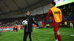 A Ball kid salutes a Liverpool player during the 2019 FIFA Club World Cup