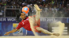 PAPEETE, FRENCH POLYNESIA - SEPTEMBER 28: Raimoana Bennet of Tahití performs a scissors kick during the FIFA Beach Soccer World Cup Tahiti 2013 Thrid Place Match at the Tahua To'ata stadium on September 28, 2013 in Papeete, French Polynesia. (Photo by Mike Hewitt - FIFA/FIFA via Getty Images)