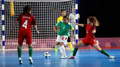 BUENOS AIRES, ARGENTINA - OCTOBER 15: Carol #5 of Portugal challenges Maria Galvez of Bolivia in the Women's Futsal semi final match between Portugal and Bolivia during the Buenos Aires Youth Olympics 2018 at Tecnopolis> on October 15, 2018 in Buenos Aires, Argentina.  (Photo by Martin Rose - FIFA/FIFA via Getty Images)