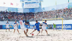 ESPINHO, PORTUGAL - JULY 19:  Anatoliy Peremitin #11 and Kirill Romanov #3 of Russia battle for the ball with Emmanuele Zurlo of Italy during the FIFA Beach Soccer World Cup 3rd place play off match between Italy and Russia held at Espinho Stadium on July 19, 2015 in Espinho, Portugal.  (Photo by Dean Mouhtaropoulos - FIFA/FIFA via Getty Images)