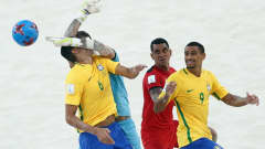 NASSAU, BAHAMAS - APRIL 28: Goalkeeper Jonathan Torohia of Tahiti makes a save against Lucao #6 of Brazil during the FIFA Beach Soccer World Cup Bahamas 2017 group D match between Braziland Tahiti at National Beach Soccer Arena at Malcolm Park on April 28, 2017 in Nassau, Bahamas  (Photo by Alex Grimm - FIFA/FIFA via Getty Images)