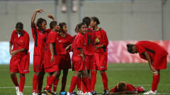 SINGAPORE - AUGUST 23: A dejected Papua New Guinea team after losing to Trinidad & Tobago in a penalty shoot out during the 5th/6th place match between Papua New Guinea and Trinidad & Tobago in the Girls Youth Olympic Football Tournament at the Jalan Besar Stadium on August 23, 2010 in Singapore, Singapore. (Photo by Julian Finney - FIFA/FIFA via Getty Images)