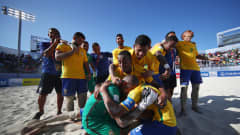 Captain, Bruno Xavier of Brazil leads the celebration after victory over Tahiti