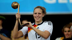 BIELEFELD, GERMANY - AUGUST 01: Kim Kulig of Germany celebrates after receiving the trophy as the third best players during the FIFA U20 Women's World Cup Final match between Germany and Nigeria at the FIFA U-20 Women's World Cup stadium on August 1, 2010 in Bielefeld, Germany. (Photo by Friedemann Vogel - FIFA/FIFA via Getty Images)