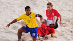 DUBAI, UNITED ARAB EMIRATES - NOVEMBER 22: Benjamin of Brazil wins the challenge with Mo Jaeggy and Stephan Leu of Switzerland during the FIFA Beach Soccer World Cup Final between Brazil and Switzerland at Umm Suqeim beach on November 22, 2009 in Dubai, United Arab Emirates. (Photo by Mike Hewitt - FIFA/FIFA via Getty Images)
