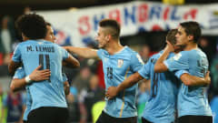 DUNEDIN, NEW ZEALAND - MAY 31:  Players from Uruguay celebrate after they defeated Serbia during the FIFA U-20 World Cup New Zealand 2015 Group D match between Uruguay and Serbia at Otago Stadium on May 31, 2015 in Dunedin, New Zealand.  (Photo by Robert Cianflone - FIFA/FIFA via Getty Images)