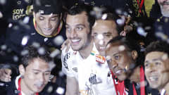 SAO PAULO, BRAZIL - JUNE 22: Players of Santos raise the trophy after winning the Santander Libertadores Cup 2011 against Penarol at Pacaembu Stadium, on June 22, 2011 in Sao Paulo, Brazil. (Photo by Keiny Andrade/LatinContent/Getty Images)