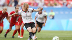 BRASILIA, BRAZIL - AUGUST 09: Melanie Behringer of Germany scores her team's first goal during the Women's First Round Group F match between Germany and Canada on Day 4 of the Rio 2016 Olympic Games at Mane Garrincha Stadium on August 9, 2016 in Brasilia, Brazil. (Photo by Celso Junior/Getty Images)