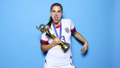 Alex Morgan of USA takes a photo with the France 2019 trophy