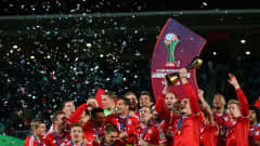 MARRAKECH, MOROCCO - DECEMBER 21:  Bayern Munchen celebrate with the trophy after the FIFA Club World Cup Final match between FC Bayern Munchen and Raja Casablanca at the Marrakech Stadium on December 21, 2013 in Marrakech, Morocco.  (Photo by Julian Finney - FIFA/FIFA via Getty Images)