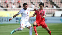 GOYANG, SOUTH KOREA - JUNE 13: Hassan Saad of Lebanon competes for the ball with Song Min-Kyu of South Korea during the FIFA World Cup Asian Qualifier 2nd round Group H match between South Korea and Lebanon at Goyang Stadium on June 13, 2021 in Goyang, South Korea. (Photo by Chung Sung-Jun/Getty Images)