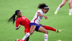 ORLANDO, FL - FEBRUARY 18: Nichelle Prince #15 of Canada attempts to steal the ball against Margaret Purce #20 of USA during the 2021 SheBelieves Cup at Exploria Stadium on February 18, 2021 in Orlando, Florida. (Photo by Alex Menendez/ Getty Images)