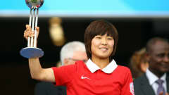 BIELEFELD, GERMANY - AUGUST 01: So Yun Ji of South Korea poses with the silver ball award after the 2010 FIFA Women's World Cup Final match between Germany and Nigeria at the FIFA U-20 Women's World Cup stadium August 01, 2010 in Bielefeld, Germany.  (Photo by Martin Rose - FIFA/FIFA via Getty Images)