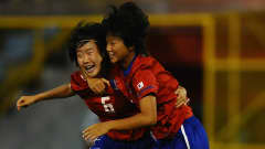 PORT OF SPAIN, TRINIDAD AND TOBAGO - SEPTEMBER 25: Lee Jungeun of South Korea is congratulated on her early goal by Kim Nari during the FIFA U17 Women's World Cup Final between South Korea and Japan at the Hasely Crawford Stadium on September 25, 2010 in Port of Spain, Trinidad And Tobago. (Photo by Laurence Griffiths - FIFA/FIFA via Getty Images)