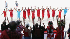 NASSAU, BAHAMAS - MAY 04:  Players of Tahiti celebrate with the fans after winning the FIFA Beach Soccer World Cup Bahamas 2017 quarter final match between Paraguay and Tahiti at National Beach Soccer Arena at Malcolm Park on May 4, 2017 in Nassau, Bahamas.  (Photo by Alex Grimm - FIFA/FIFA via Getty Images)