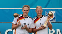 BIELEFELD, GERMANY - AUGUST 01: Kim Kulig and Alexandra Popp of Germany pose with their trophees after winning the FIFA U20 Women's World Cup Final match between Germany and Nigeria at the FIFA U-20 Women's World Cup stadium on August 1, 2010 in Bielefeld, Germany. (Photo by Friedemann Vogel - FIFA/FIFA via Getty Images)