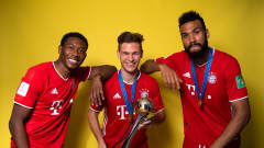 Joshua Kimmich, David Alaba and Eric Choupo Moting of FC Bayern Muenchen posing with the FIFA Club World Cup trophy (David Ramos / Getty)