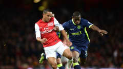 LONDON, ENGLAND - APRIL 16:  Theo Walcott of Arsenal is challenged by Maynor Figueroa of Wigan during the Barclays Premier League match between Arsenal and Wigan Athletic at Emirates Stadium on April 16, 2012 in London, England.  (Photo by Laurence Griffiths/Getty Images)