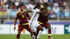 SUWON, SOUTH KOREA - JUNE 11:  Kyle Walker-Peters of England and Sergio Cordova of Venezuela battle for the ball  during the FIFA U-20 World Cup Korea Republic 2017 Final between Venezuela and England at Suwon World Cup Stadium on June 11, 2017 in Suwon, South Korea.  (Photo by Lars Baron - FIFA/FIFA via Getty Images)