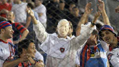 A supporter of Argentina's San Lorenzo is seen wearing a Pope Francis costume
