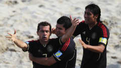 RAVENNA, ITALY - SEPTEMBER 08: Antonio Barbosa(#7) of Mexico celebrates scoring a goal with team mates during the FIFA Beach Soccer World Cup Quarter Final match between Russia and Mexico at Stadium del Mare on September 8, 2011 in Ravenna, Italy. (Photo by Dean Mouhtaropoulos - FIFA/FIFA via Getty Images)