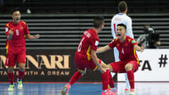 KAUNAS, LITHUANIA - SEPTEMBER 19: Doan Phat Chau of Vietnam celebrates with teammate Duc Hoa Pham after scoring their team's first goal during the FIFA Futsal World Cup 2021 group D match between Czech Republic and Vietnam at Kaunas Arena on September 19, 2021 in Kaunas, Lithuania. (Photo by Angel Martinez - FIFA/FIFA via Getty Images)