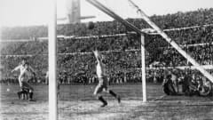 Argentinian goalkeeper Juan Botasso is beaten by Hector Castro (partly hidden, right) for Uruguay's 4th goal during the FIFA World Cup Final at the Estadio Centenario in Montevideo, 30th July 1930. Uruguay defeated Argentina 4-2 to win the Jules Rimet Trophy. (Photo by Bob Thomas/Popperfoto/Getty Images)