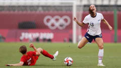 KASHIMA, JAPAN - AUGUST 02: Alex Morgan #13 of Team United States reacts after a challenge by Quinn #5 of Team Canada during the Women's Semi-Final match between USA and Canada on day ten of the Tokyo Olympic Games at Kashima Stadium on August 02, 2021 in Kashima, Ibaraki, Japan. (Photo by Francois Nel/Getty Images)