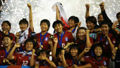 PORT OF SPAIN, TRINIDAD AND TOBAGO - SEPTEMBER 25: The South Korea Team celebrate victory over Japan in the FIFA U17 Women's World Cup Final between South Korea and Japan at the Hasely Crawford Stadium on September 25, 2010 in Port of Spain, Trinidad And Tobago. (Photo by Laurence Griffiths - FIFA/FIFA via Getty Images)