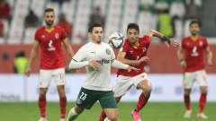 DOHA, QATAR - FEBRUARY 11: Raphael Veiga of SE Palmeiras controls the ball under pressure from Taher Mohamed of Al Ahly SC during the FIFA Club World Cup Qatar 2020 3rd Place Play off match between Al Ahly and SE Palmeiras at the Education City Stadium on February 11, 2021 in Doha, Qatar. (Photo by Mohamed Farag - FIFA/FIFA via Getty Images)