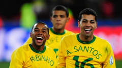 JOHANNESBURG, SOUTH AFRICA - JUNE 28: Robinho (L) of Brazil and team mate Andre Santos celebrate following their team's victory at the end of the FIFA Confederations Cup Final between USA and Brazil at the Ellis Park Stadium on June 28, 2009 in Johannesburg, South Africa. (Photo by Jamie McDonald/Getty Images)