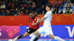 VILNIUS, LITHUANIA - SEPTEMBER 18: Abdelrahman Elashwal of Egypt and Ikhtiyor Ropiev of Uzbekistan challenge for the ball during the FIFA Futsal World Cup 2021 group B match between Guatemala and Football Union Of Russia at Kaunas Arena on September 18, 2021 in Kaunas, Lithuania. (Photo by Alexander Scheuber - FIFA/FIFA via Getty Images)