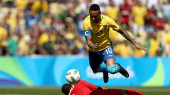 RIO DE JANEIRO, BRAZIL - AUGUST 17:  Neymar of Brazil rounds the keeper to score the first Brazil goal during the Men's Semifinal Football match between Brazil and Honduras at Maracana Stadium on Day 12 of the Rio 2016 Olympic Games on August 17, 2016 in Rio de Janeiro, Brazil.  (Photo by Buda Mendes/Getty Images)