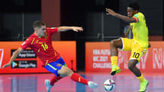 KLAIPEDA, LITHUANIA - SEPTEMBER 20: Manosele of Angola is challenged by Miguel Mellado of Spain during the FIFA Futsal World Cup 2021 group E match between Spain and Angola at Klaipeda Arena on September 20, 2021 in Klaipeda, Lithuania. (Photo by Chris Ricco - FIFA/FIFA via Getty Images)