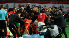 OSAKA, JAPAN - DECEMBER 13:  Guangzhou Evergrande FC celebrate with coach Luis Felipe Scolari centre after Paulinho's winning goal during the FIFA Club World Cup Japan 2015 quarter final between Club America and Guangzhou Evergrande FC at Osaka Nagai Stadium on December 13, 2015 in Osaka, Japan.  (Photo by Mike Hewitt - FIFA/FIFA via Getty Images)
