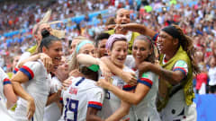 LYON, FRANCE - JULY 07:  Megan Rapinoe of the USA celebrates with teammates after scoring her team's first goal during the 2019 FIFA Women's World Cup France Final match between The United States of America and The Netherlands at Stade de Lyon on July 07, 2019 in Lyon, France. (Photo by Richard Heathcote/Getty Images)