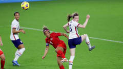 ORLANDO, FL - FEBRUARY 18: Rose Lavelle #16 of USA heads the ball against Desiree Scott #11 of Canada during the SheBelieves Cup at Exploria Stadium on February 18, 2021 in Orlando, Florida. (Photo by Alex Menendez/Getty Images)